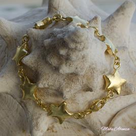 Estrellas de plata bañada en oro