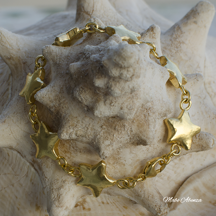 Estrellas de plata bañadas en oro